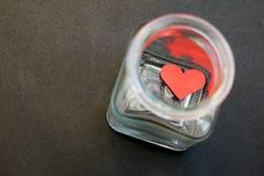 Coeur emprisonné dans un pot en verre - série 2 Photos stock