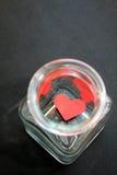 Coeur emprisonné dans un pot en verre - série 3 Image stock