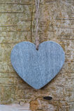 Coeur en bois d'amour de texture sur le tronc d'arbre Photo stock