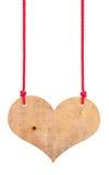 Coeur en bois sur cordes Image stock