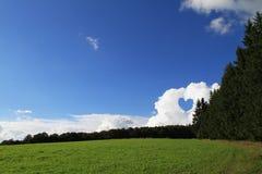 Coeur en nuages Photos libres de droits