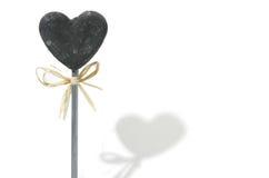 Coeur en pierre avec l'ombre d'isolement sur le blanc Images stock