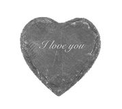 Coeur en pierre sur le fond blanc Photographie stock