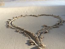 Coeur en sable Photo libre de droits