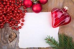 Coeur en verre de whith de carte de voeux de Noël Image stock