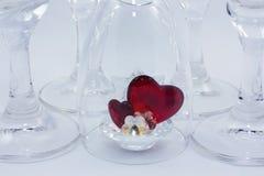 Coeur en verre sous le verre Images libres de droits