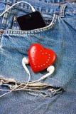 Coeur et écouteurs Photos stock