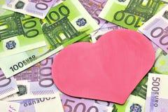 Coeur et argent Photo libre de droits