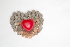 Coeur et argent rouges Photographie stock