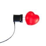 Coeur et chargeur rouges sur le blanc Photos libres de droits