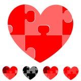 Coeur et coeurs avec des puzzles noirs gris rouges Photographie stock