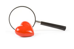 Coeur et loupe rouges Photos libres de droits