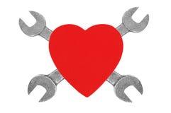 Coeur et outils. Concept : Rénovation de coeur. Images stock