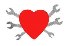 Coeur et outils. Concept : Rénovation de coeur Image libre de droits