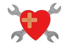 Coeur et outils. Concept : Rénovation de coeur. Photos stock