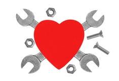 Coeur et outils. Concept : Rénovation de coeur. Images libres de droits