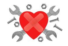 Coeur et outils. Concept : Rénovation de coeur. Photo libre de droits