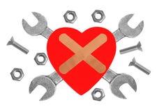 Coeur et outils. Concept : Rénovation de coeur. Photographie stock libre de droits