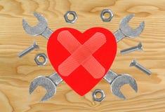 Coeur et outils Concept : Rénovation de coeur Image libre de droits
