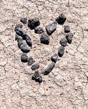Coeur fabriqué à la main dans le désert Photos libres de droits