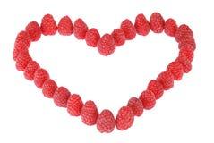 Coeur fabriqué à partir de des framboises Photographie stock libre de droits