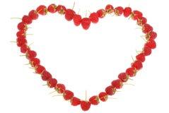 Coeur fabriqué à partir de des framboises Images stock