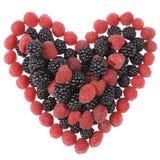 Coeur fabriqué à partir de des framboises et des mûres Photos stock