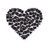 Coeur fait avec les cadres vides de photo Images stock