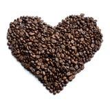 Coeur fait de grains de café - photo courante Photo stock