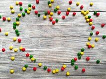 Coeur fait de sucreries colorées Photos stock