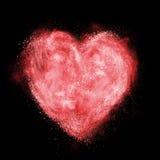 Coeur fait en explosion blanche de poudre d'isolement Image libre de droits