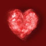 Coeur fait en explosion de poudre sur le rouge Photos stock