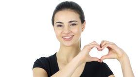 Coeur fait main pour exprimer l'amour par la femme Photos stock