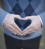 Coeur formé par main Photographie stock