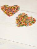 Coeur-forme des confettis de sucrerie Photos libres de droits
