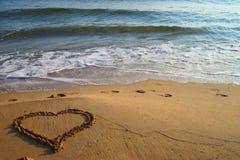 Coeur sur la plage Photo stock
