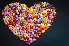 Coeur glacé coloré de sucreries de graine de tournesol Images libres de droits