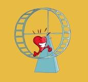 Coeur heureux fonctionnant sur une roue de hamster Photo libre de droits