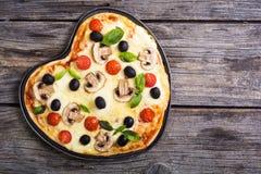 Coeur italien de pizza Photos stock