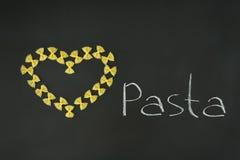 Coeur marqueté par arc de pâtes Photo libre de droits