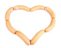 Coeur mini de plan rapproché d'isolement de saucisses par réseau Photos libres de droits