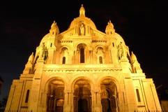 coeur montmartre晚上巴黎sacre 免版税图库摄影