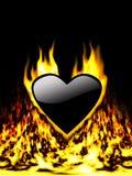 Coeur noir en incendie Images stock