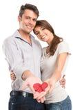 Coeur peint par apparence affectueuse de couples en main Image stock