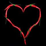 Coeur. Poivrons de piment d'un rouge ardent Image stock