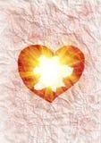 Coeur rayonnant la lumière Images libres de droits
