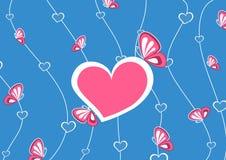 Coeur rose, sur le fond bleu Photo libre de droits
