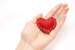 Coeur rouge à disposition Image libre de droits