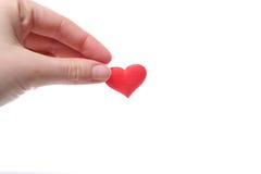 Coeur rouge à disposition Photographie stock libre de droits