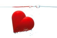 Coeur rouge avec des bulles photos stock